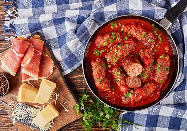Beef braciole in marinara sauce.